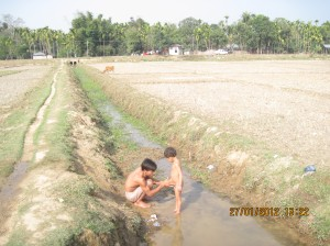 Villagers taking bath in the cannel, the only source of water.
