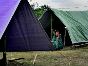 A riot victim woman whose house was burnt down by the militants takes shelter at a relief camp in Narayanguri village in Baksa district of Assam. Photo: The Hindu